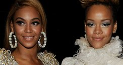 Beyonce Knowles (L) and Rihanna (R) backstage duri
