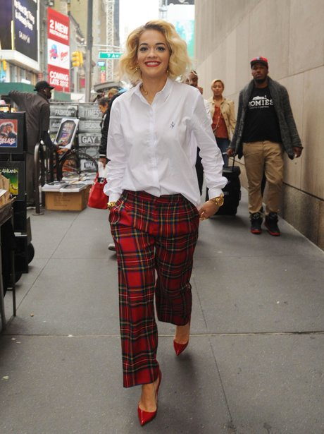 Rita Ora wearing tartan trousers in New York.