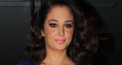 Tulisa wearing a short blue dress