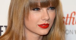 Taylor Swift turns on the Christmas lights at West