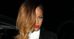 Rihanna with long hair on a night out