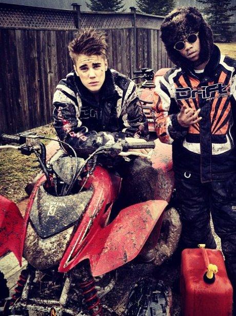 Justin Bieber on a quad bike with friends
