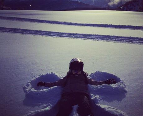 Nicole Scherzinger makes a snow angel in the ground