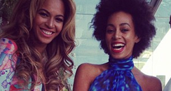 Beyonce and Solange smiling before Grammy Awards