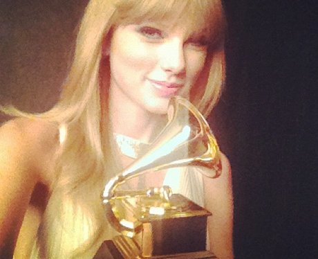 Taylor Swift shows off her Grammy Award