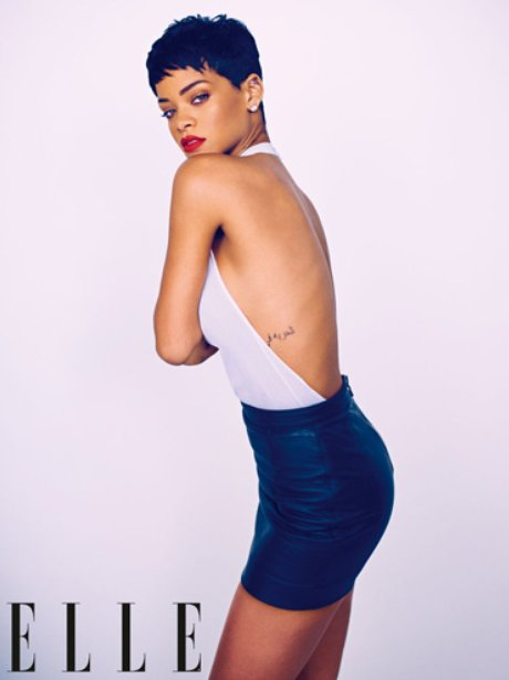 Rihanna wearing leather mini skirt for Elle magazine