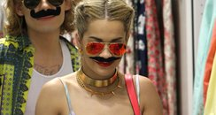 Rita Ora wearing a moustache