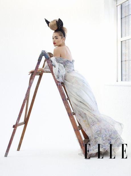 Rita Ora lying on a ladder