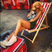 Image 5: Rihanna relaxing on a deck chair