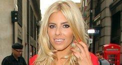 Mollie King in a red dress