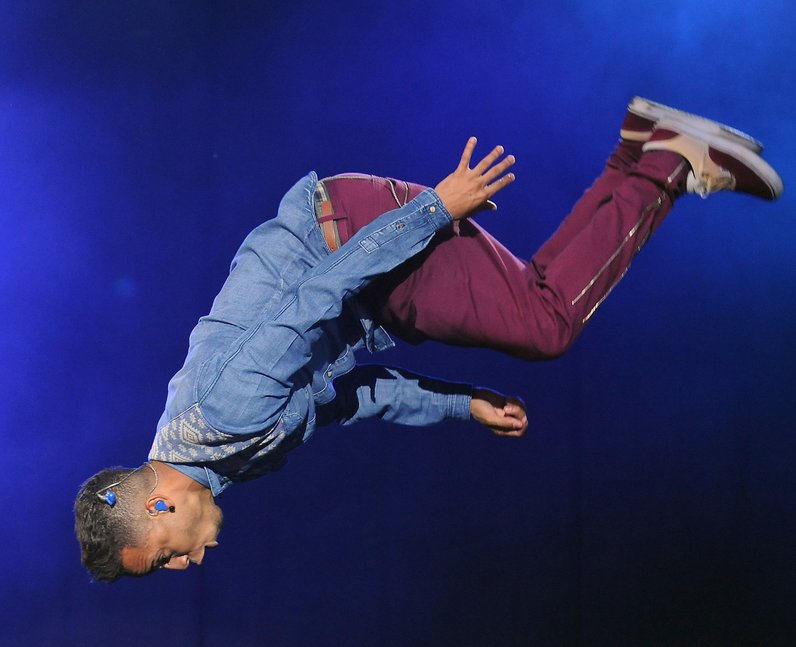 JLS star Aston Merrygold pulls out his trademark backflip at Fusion Festival 2013