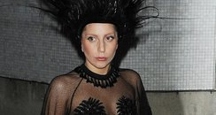 Lady Gaga wearing a peacock hat