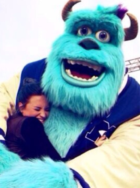 Demi Lovato and Sully from Monsters University