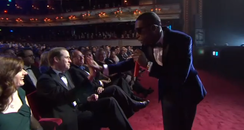 Prince William high-fiving Tinie Tempah