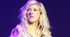 Ellie Goulding wearing a leotard on stage
