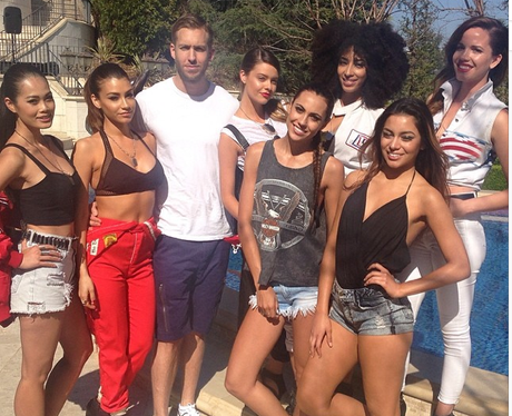 Calvin Harris with women by a pool