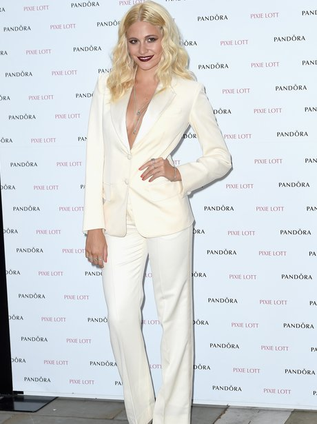 Pixie Lott low cut tuxedo album launch party