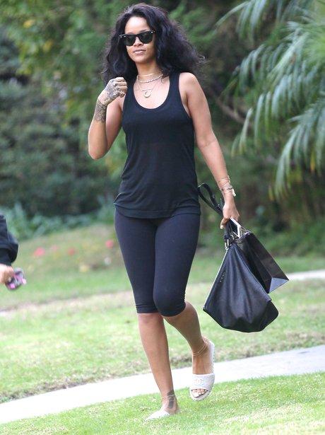 Rihanna wearing black leggings