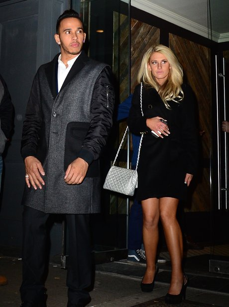 Lewis Hamilton and mystery woman leaving club