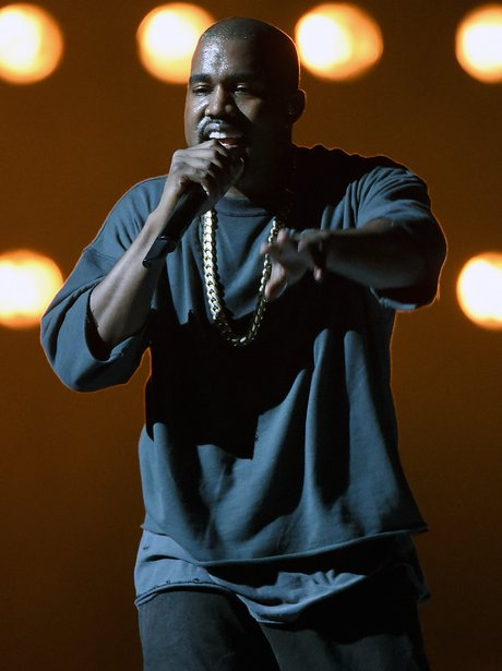 Kanye West performs live on stage in September 2015