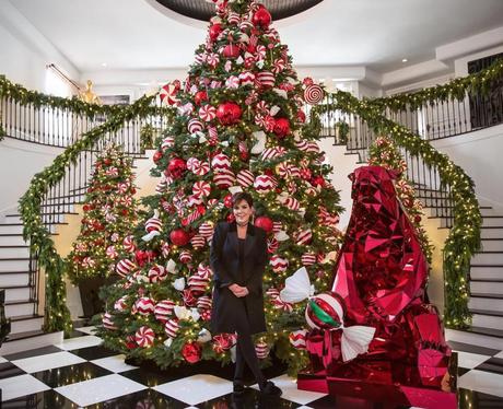 Kris Jenner poses infront of her massive Christmas